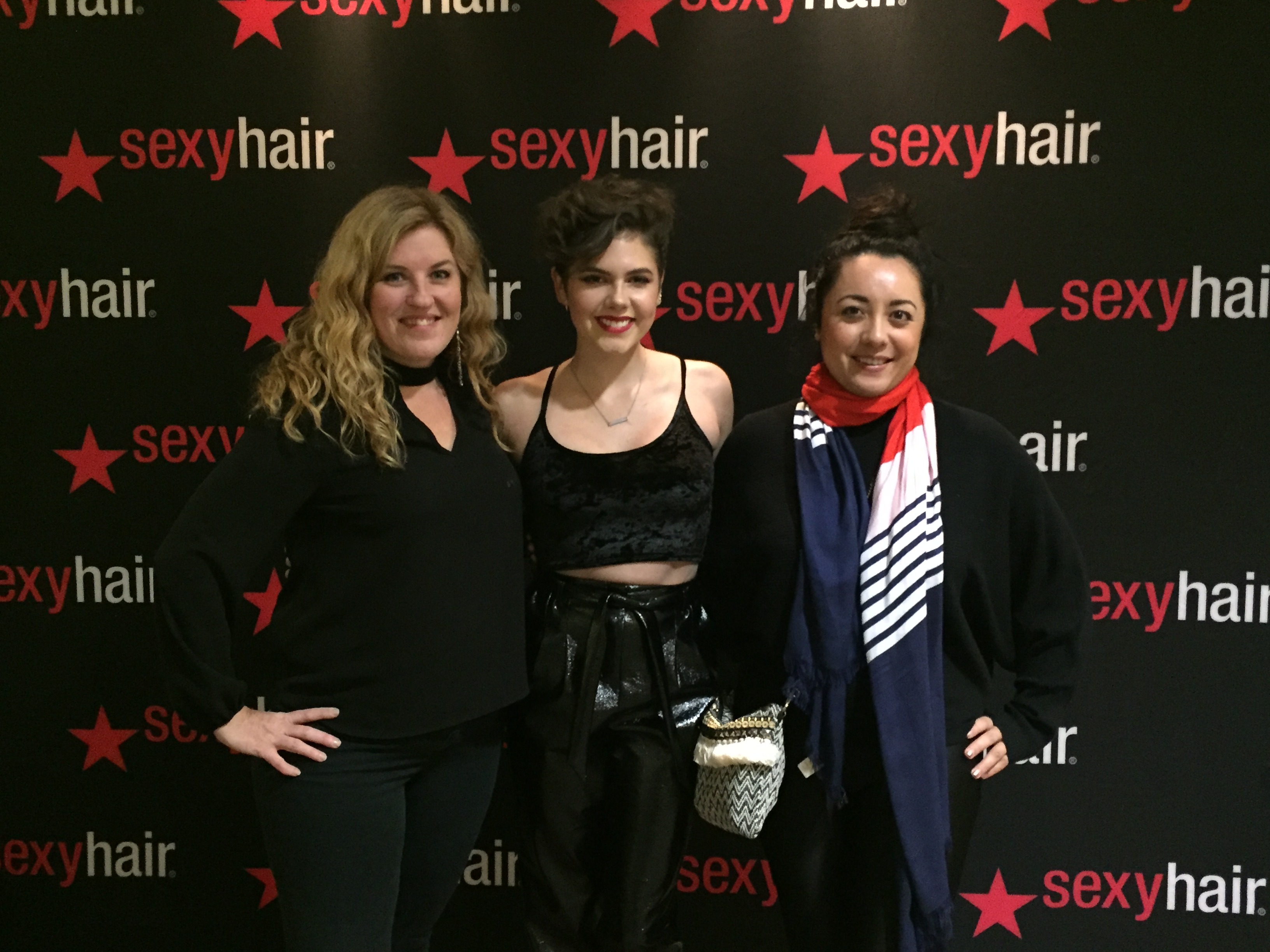American Salon Editor in Chief Amy Dodds (left) poses with singer Calysta Bevier and West Coast Editor Kamala Kirk during Sexy Hair's Red Party.