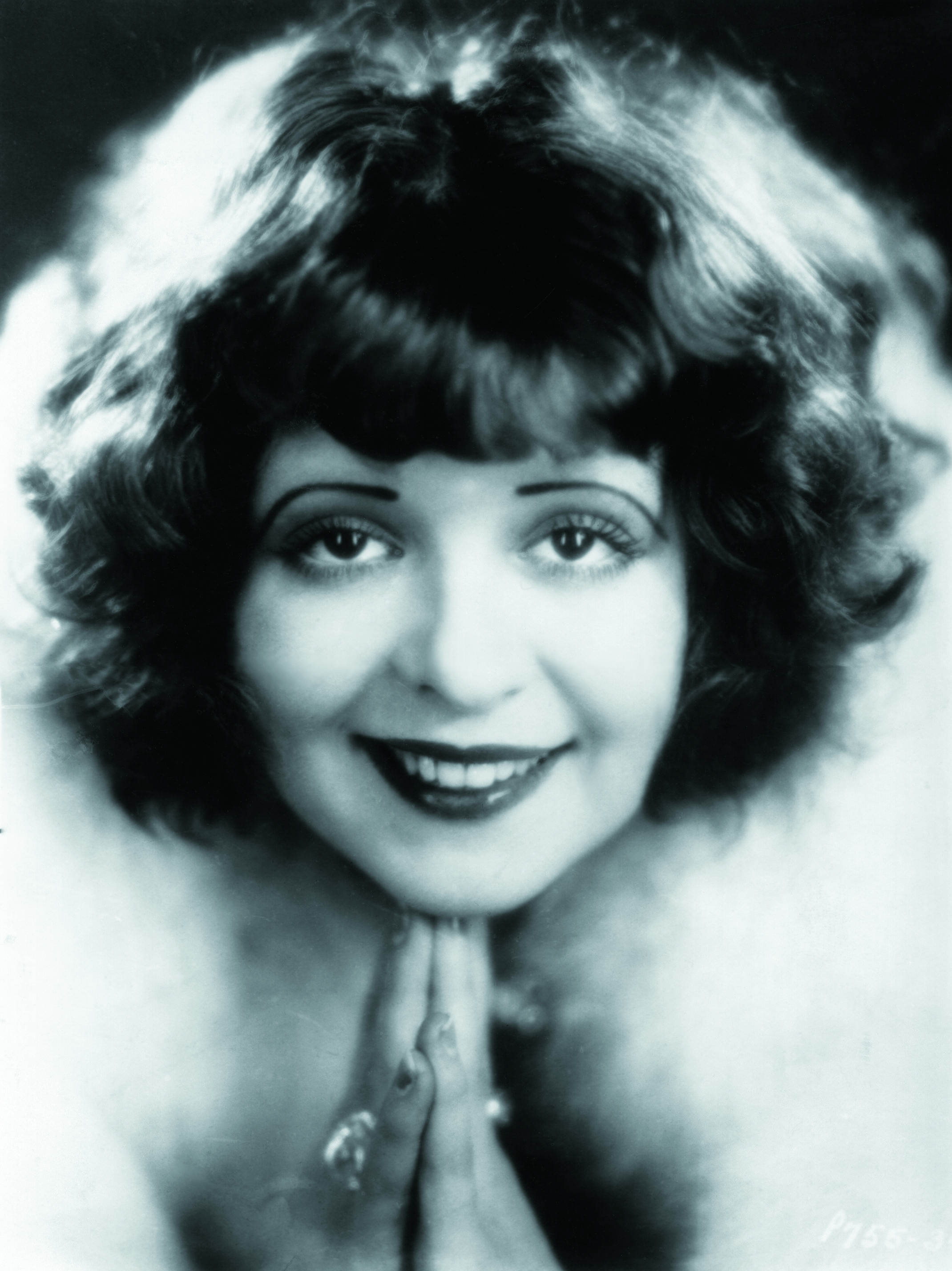 Clara Bow, one of the most popular silent film stars, was  known for her red curls and bangs.