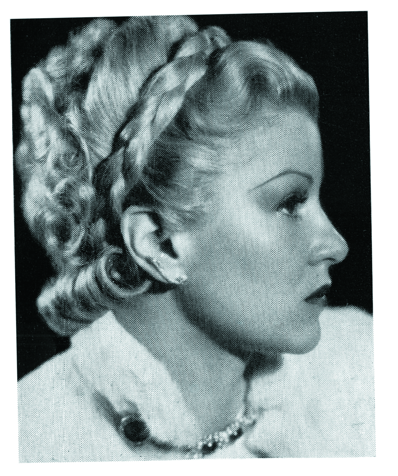 Fox Film star Claire Trevor shows off the popular coronet coiffure.