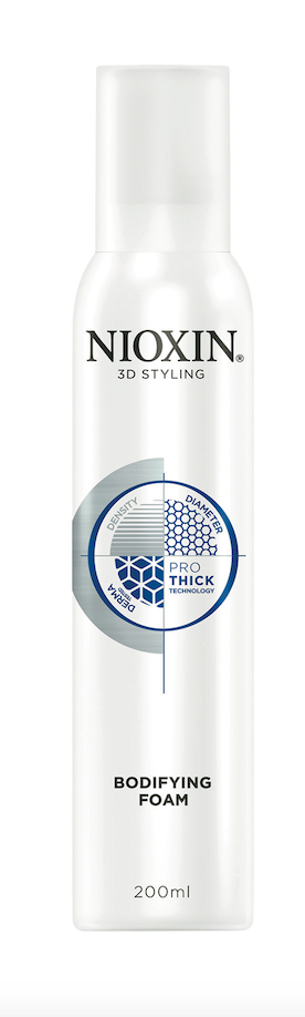 Nioxin Bodifying Foam provides hold and creates a fuller, thicker look—while also giving hair a more manageable texture.