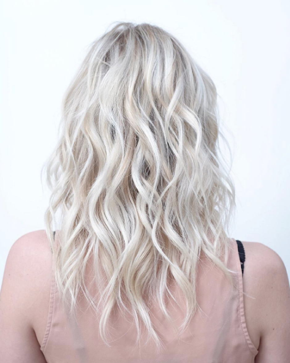 An icy blonde balayage by @christinesilvermancolor.