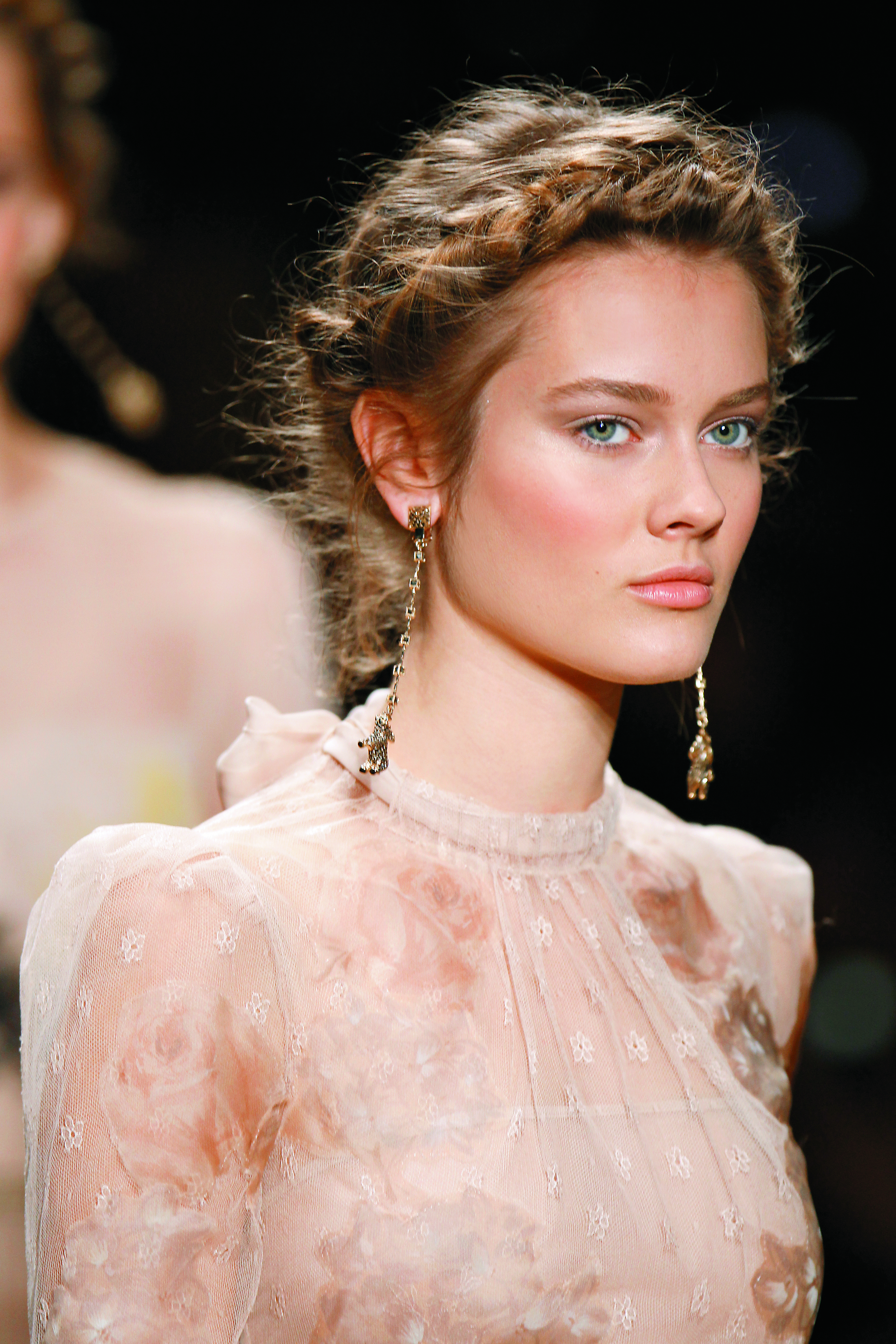 """Valentino's Spring/Summer 2012 season focused on natural beauty, high-drama updos and intricate braids, because as anyone who follows fashion knows, braids are here to stay."""