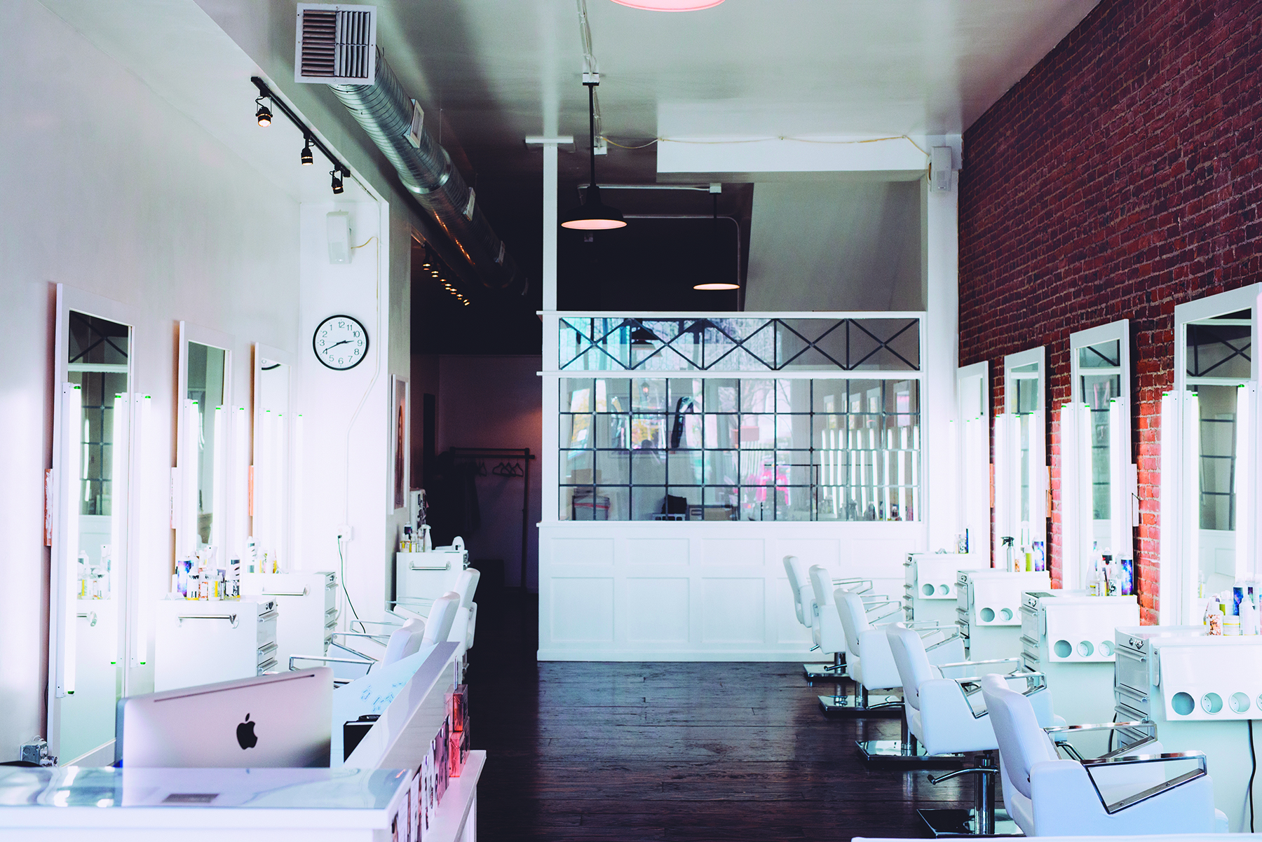 A view of the salon's clean, white interior.