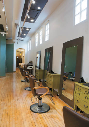 The styling area features high ceilings, light hardwood floors and large mirrors