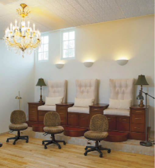 A chandelier and wall sconces add to the salon's chic factor