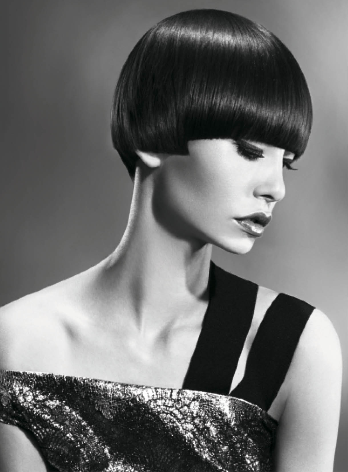 For this geometric hairstyle, Mather cut a sharp, rounded pageboy and flat-dried hair following its strong directional growth pattern, ensuring strands glided across the head. She finished with a light shine spray.