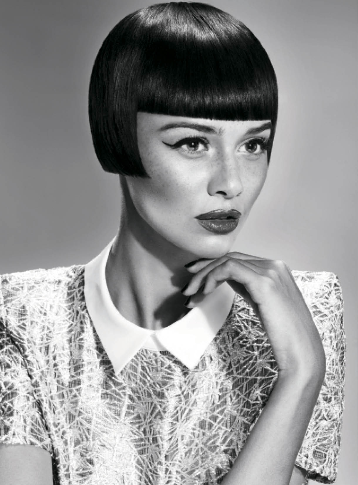 This ear-length bob with a short fringe emphasizes the retro look of the 1950s, Mather says. To style, she blow-dried hair smooth for a sleek finish.