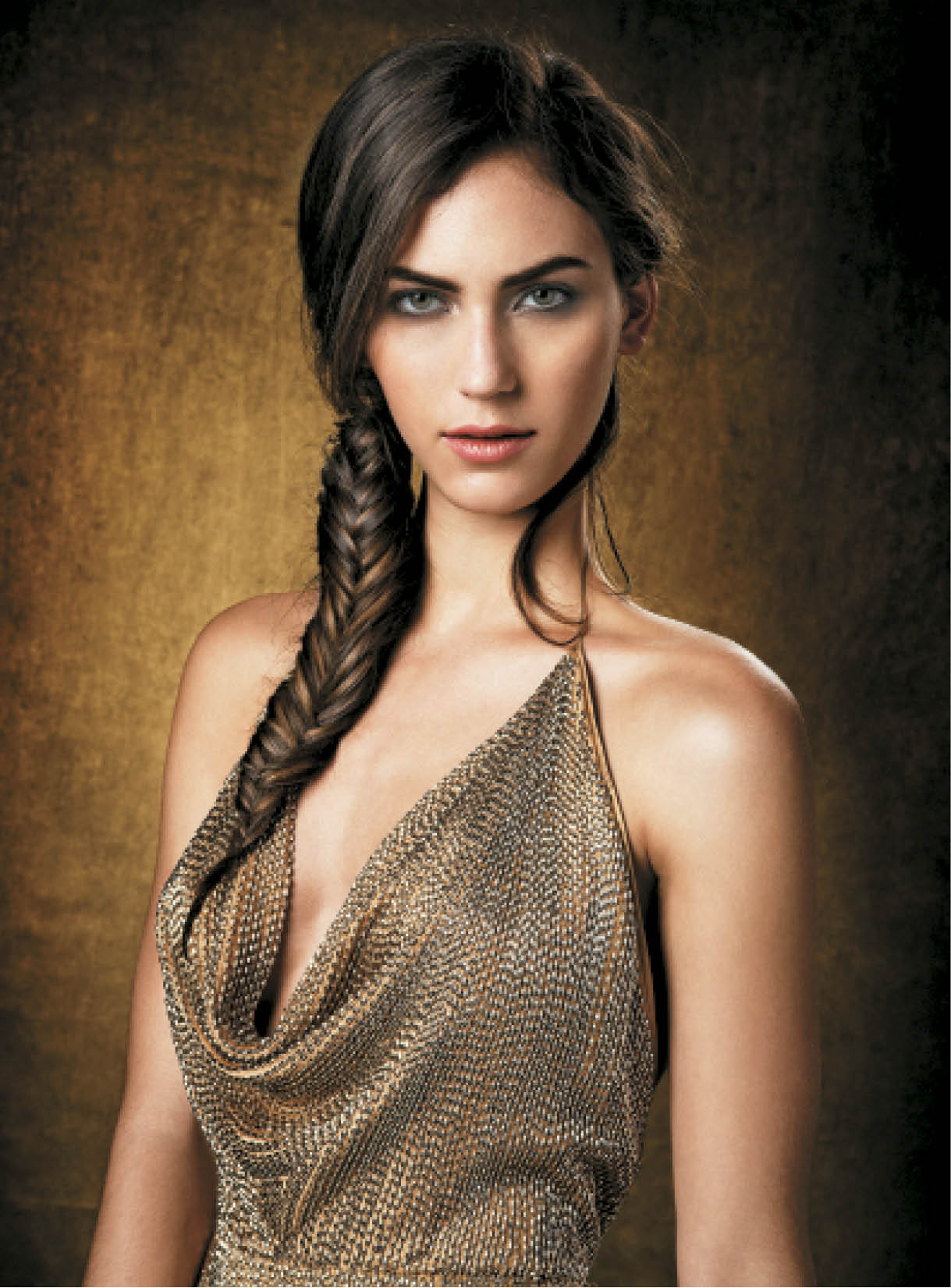 """Jordan is our Amanda Peet and emphasizes that highlights can be done on brunettes too, not just blondes,"" Cunningham says. ""She started as a natural level 3 with medium brown hair. I love how the subtle lift comes through in her fishtail braid."