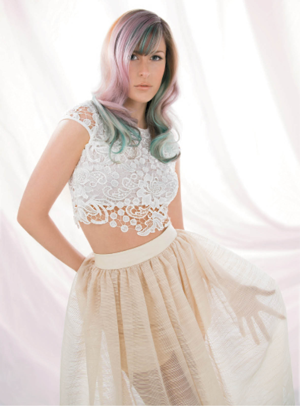 For this reinterpretation of the Journey to Enlightenment trend, Brenton Lee called on Wella Professionals' new Instamatic by Color Touch to imbue the hair with pink dream, jaded mint and ocean storm, before styling it with 1- and ½-inch curling irons to softly set strands.
