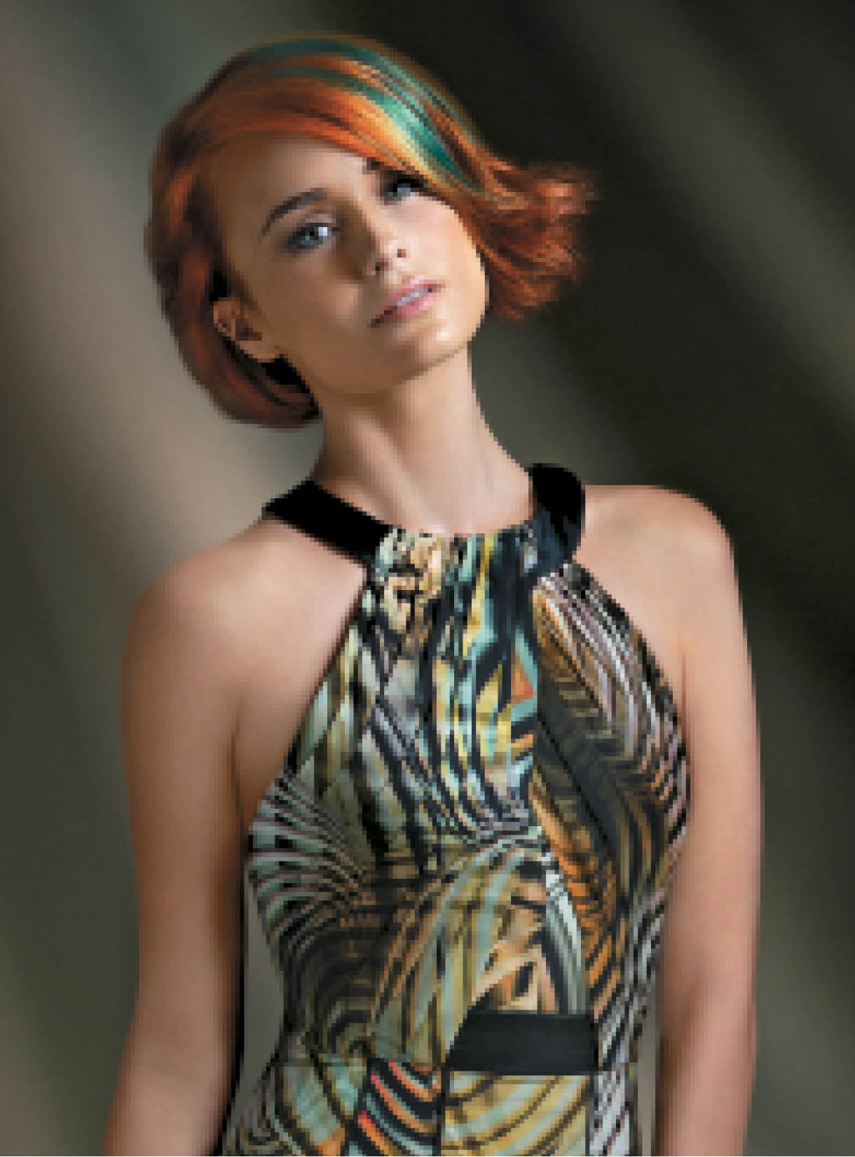 For this take on the New Frontier Uncharted Territories trend, Basham created coppery and vibrant red hues in the hair with Wella Professionals Koleston Perfect and Color.id. After working Velvet Amplifier into damp hair, she blow-dried strands using a round brush for volume and movement, then misted them with Stay Essential Finishing Spray.