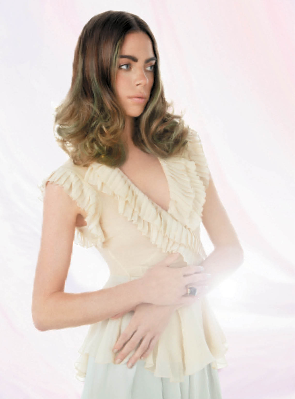 Ashton Morgan put a spin on the Journey of Enlightenment trend with Wella Professionals Illumina Color, which she applied from the base to mid-shaft. She used Blondor Freelights to balayage highlights for a mix of light and dark hues in the hair.