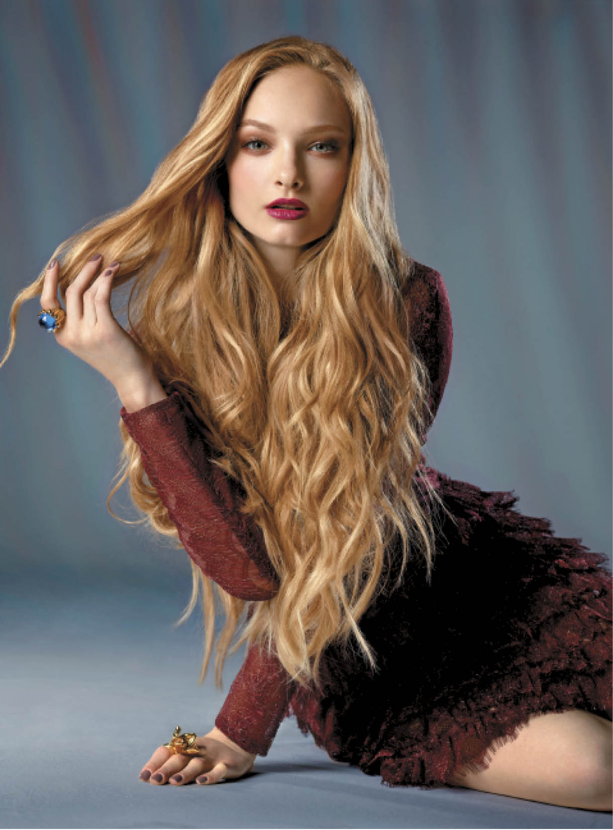 Quarles prepped the hair with the Obliphica Seaberry range before applying Seaberry Curl Cream and blow-drying locks to bring out natural texture. He wrapped small hair sections around a bi-tube iron and wrapped larger sections as he moved up the head for softer waves, finishing with the largest sections at the crown.  Dress: Tadashi Shoji;  Rings: MCL