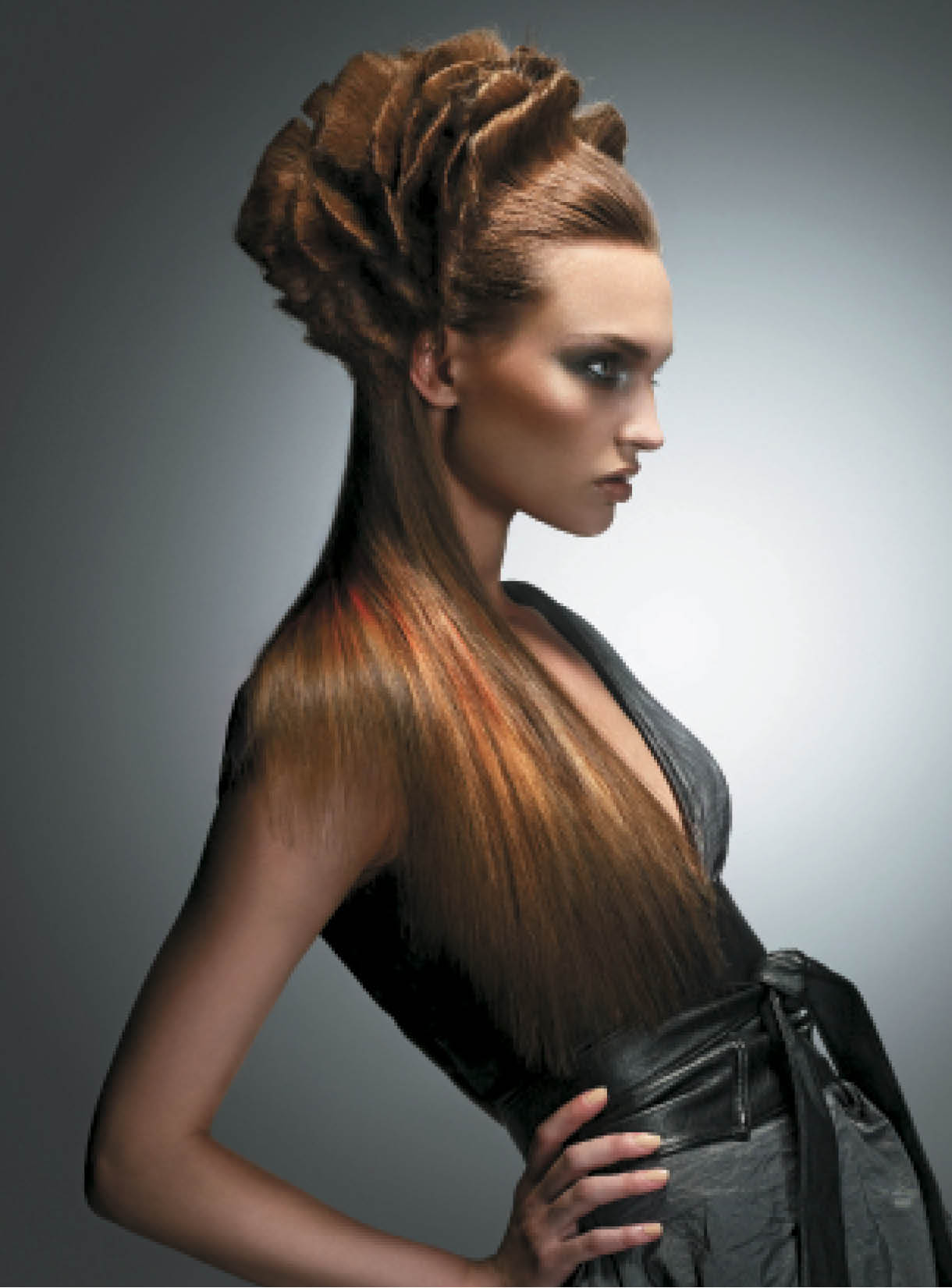 For color, Seung-Ki Baek highlighted the hair a red-blonde for an eye-catching look. To style, he backcombed the hair for volume and hold, then misted hairspray. Next, he folded the hair in and out with a flat-iron to create an origami effect, relying on L'Oréal Professionnel Tecni.Art Air Fix and Crystal Gloss to give hold and shine.