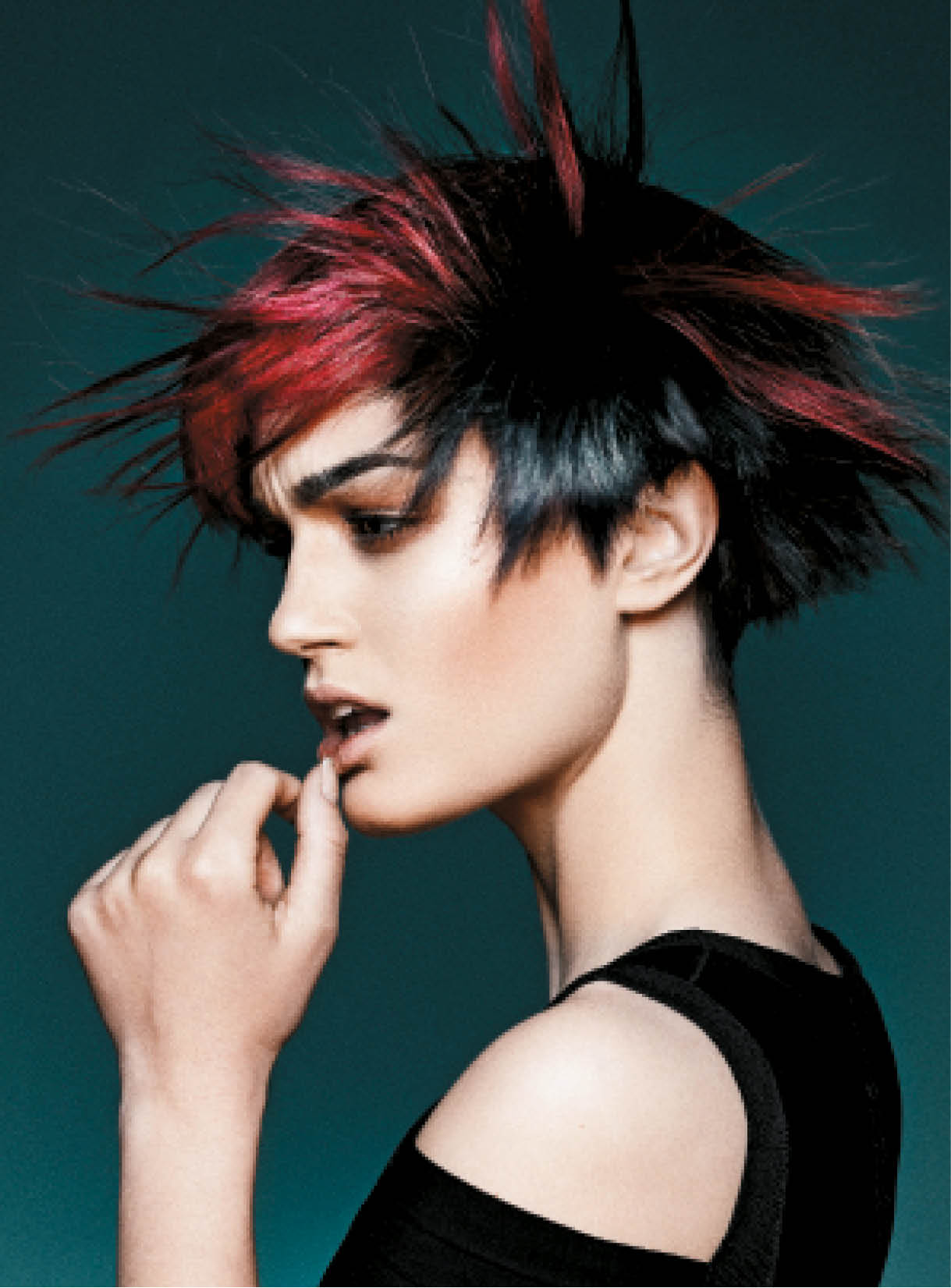 For thie eye-catching look, Barton paired vivid red and dark hues, and turned up the texture.