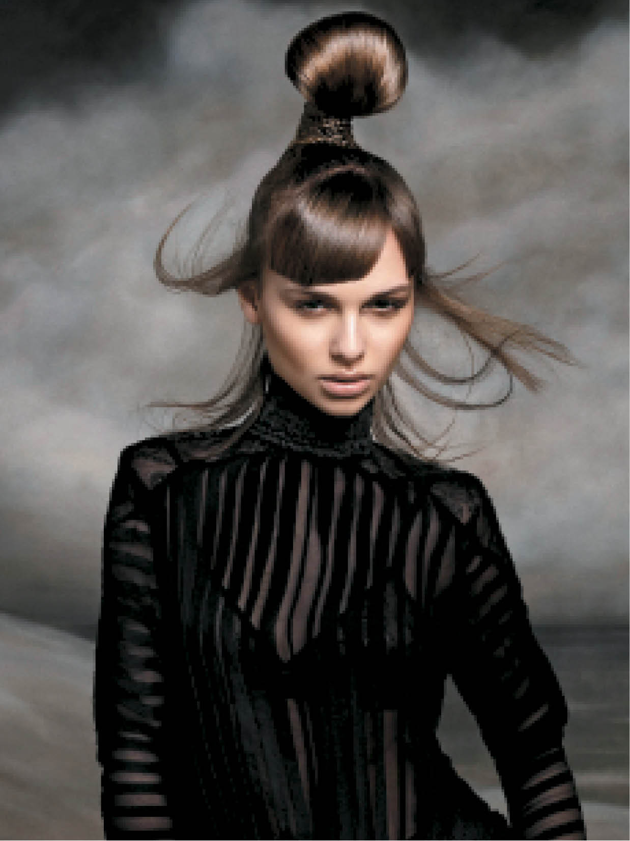 To craft a trendy topknot, the team left sections out in the front and side of the head as they brushed locks into a sleek, high ponytail. Then they combed hair back and smoothed it. They plaited the remaining hair, and wrapped it around the topknot.