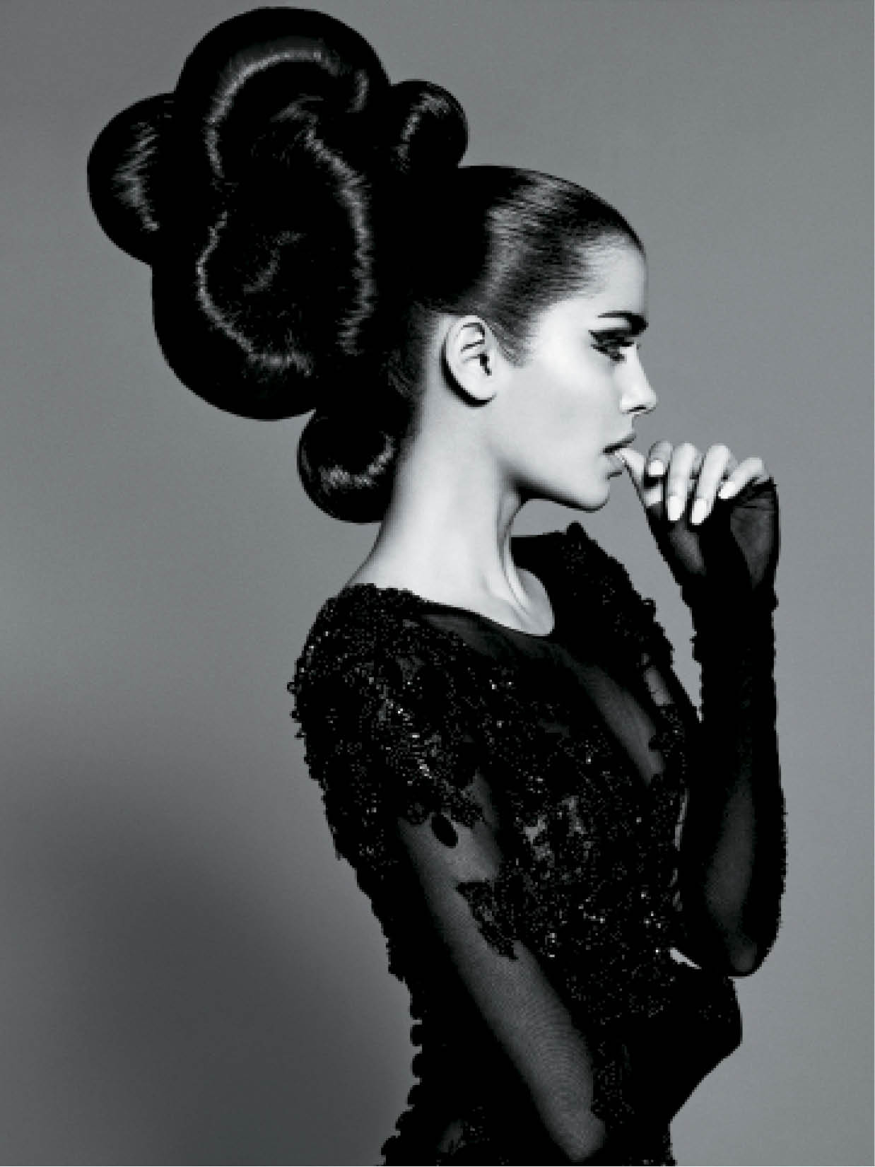 "Caterina Di Biase calls this a ""runaway ponytail."" She created a three-part pony, then sewed extensions onto donuts that she positioned into a modern updo."