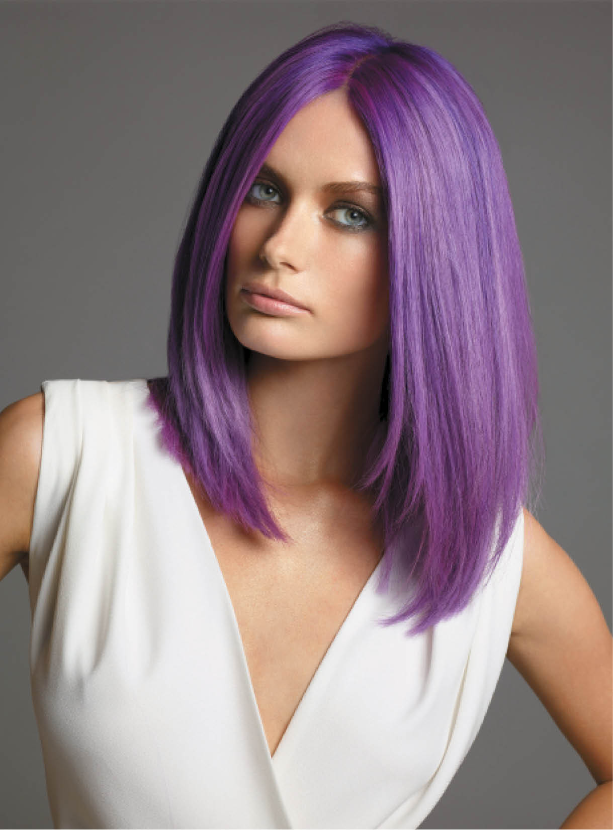 Alfredo Luciano took model Flora's natural blonde to a vibrant purple. He used B3 Brazilian Bond Builder for a bleach cap and used it once more when applying the violet fashion shade.