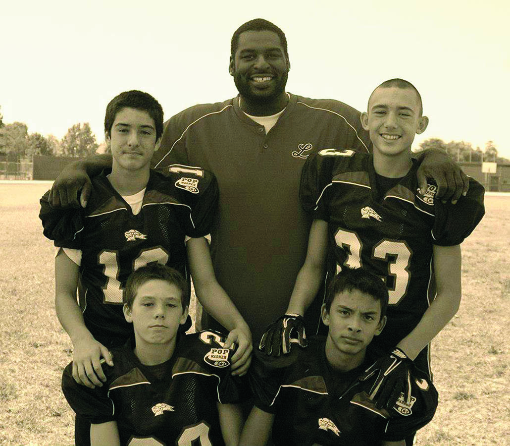 Mosley with thePop Warner kids that he coaches