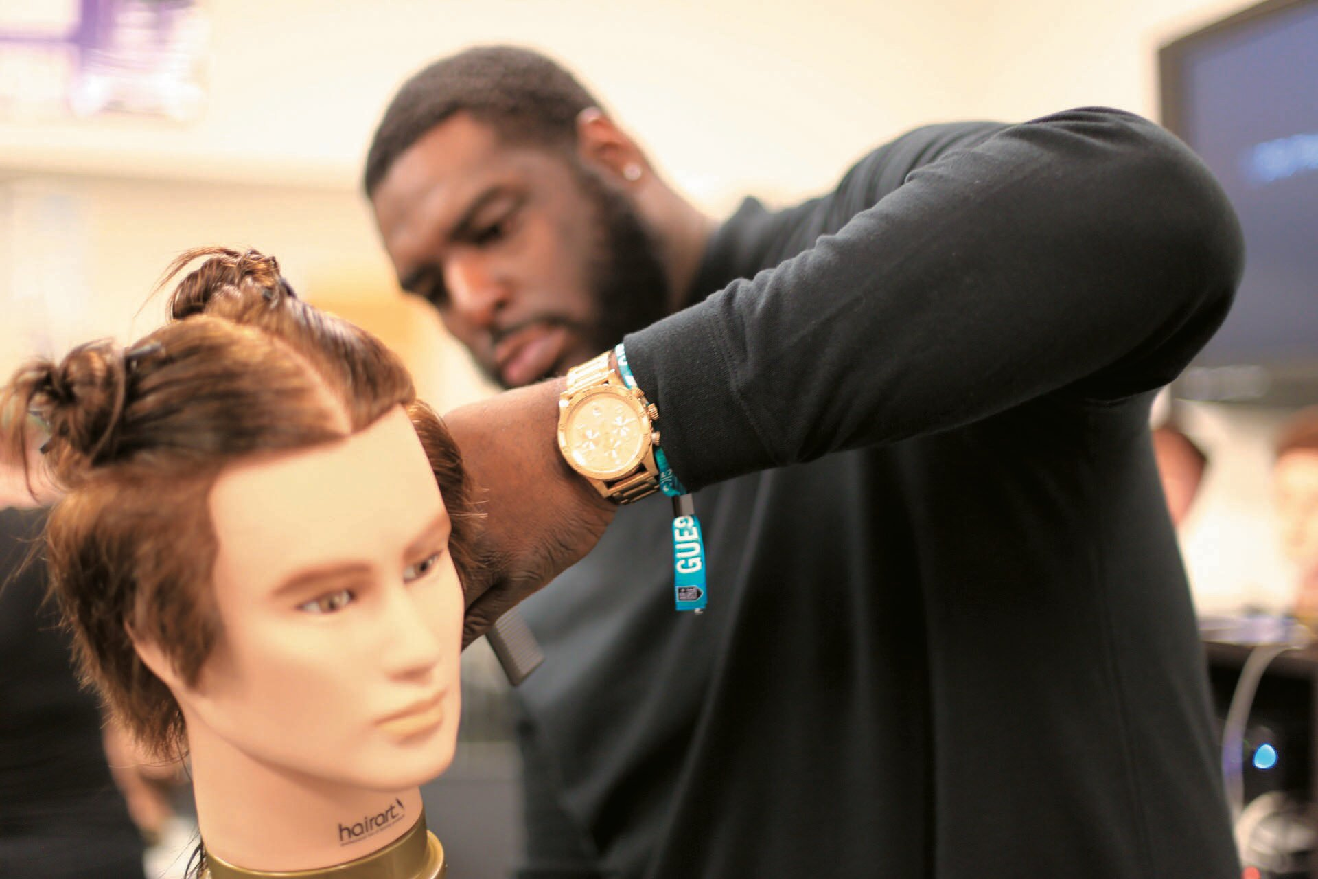 John Mosley demonstrating a technique on a mannequin head