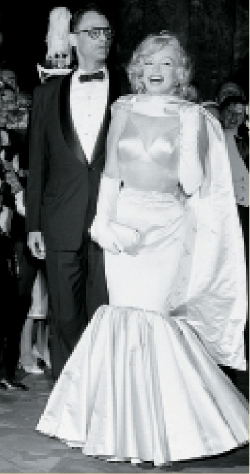 Marilyn Monroe shows off Lynn's work with then-husband Arthur Miller at the 1957 premier of The Prince and the Showgirl