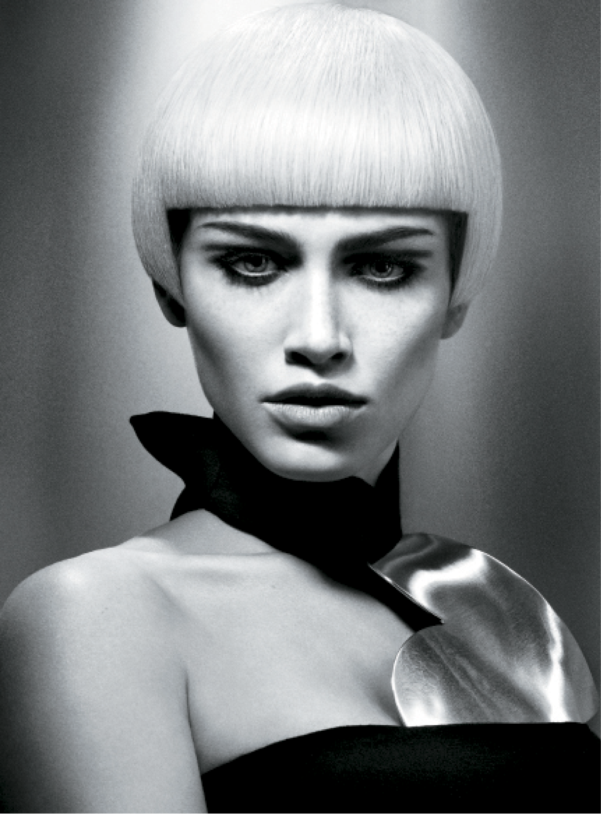 For this sleek bob, Leeson applied straightening balm and smoothing serum to damp hair before using a Denman flat-iron to wrap dry and smooth the hair. Using a Denman brush, he blow-dried the hair to keep the cuticles smooth. For a sleek finish, he used heat protection spray and straightening irons to smooth strands and the fringe.