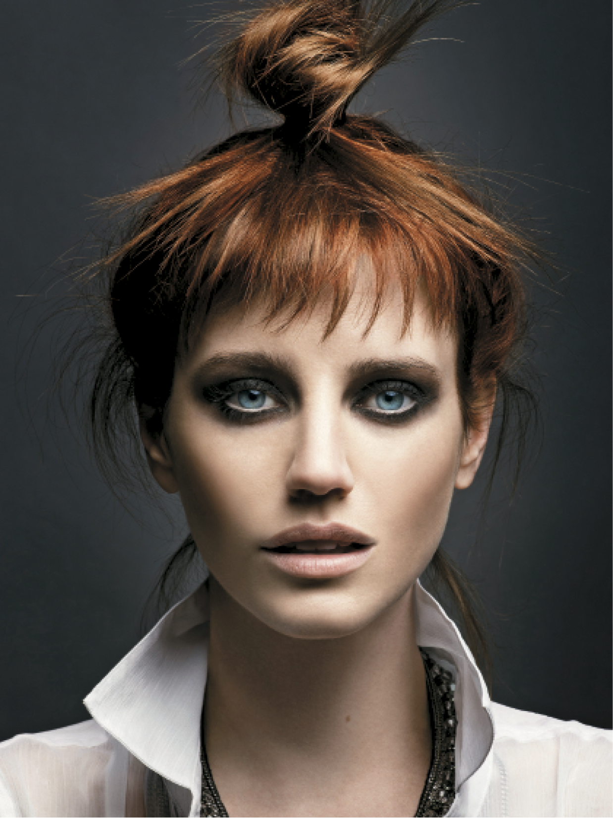 When creating this look, Baxter added vibrant copper hues to a natural copper base, which he says gives the color a surprise element. The hair was then styled in a top knot to show off the color and create a casual feel.