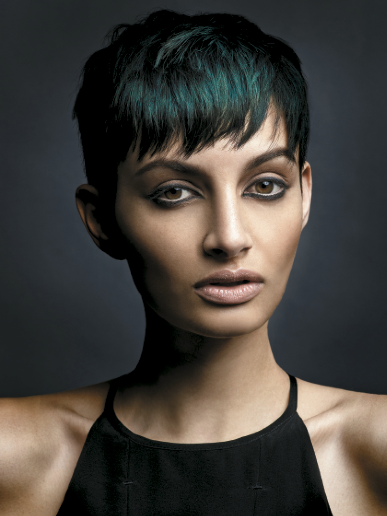 Using two prism sections through the fringe area, Baxter lightened the ends and isolated them with foil or mesh and applied a cool, dark global color to the remaining hair. He rinsed hair and applied a deep turquoise hue to create a seamless look with no visible sectioning pattern.