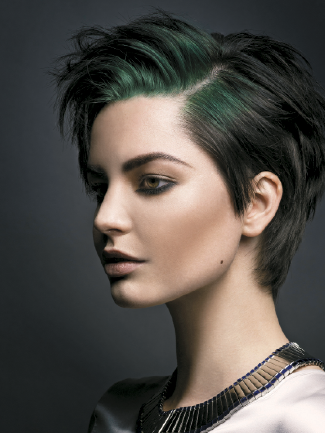 To achieve this look, Baxter pre-lightened the first 2 inches of the hair from the root area, then applied a Goldwell Elumen smoky green hue over the top, creating a subtle glow at the root that fades to natural color.