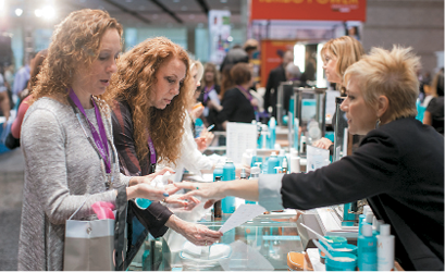 Attendees at the Moroccanoil booth