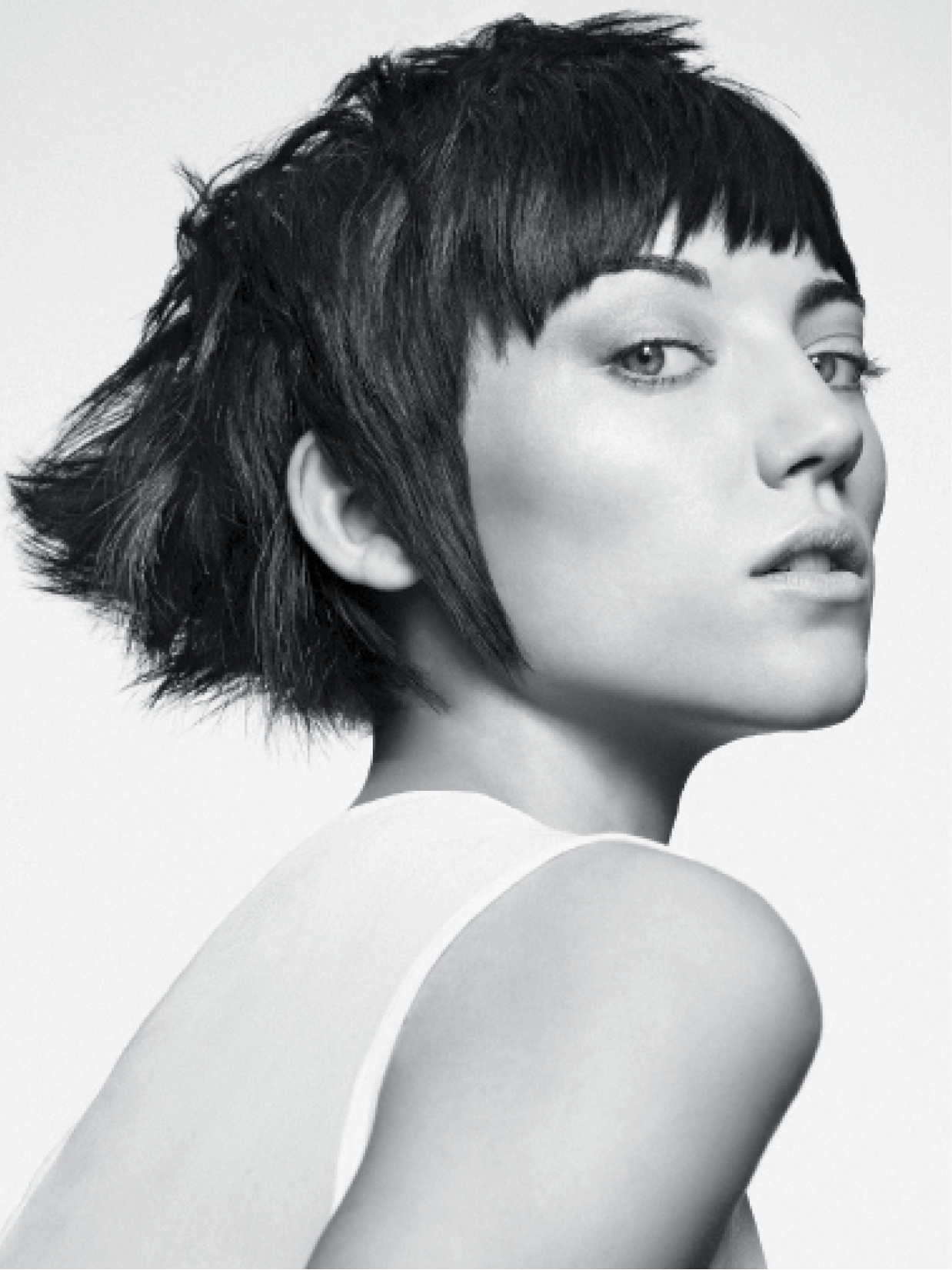 To create this raw and edgy shape, Turnbull used slide-cutting; deep point-cutting; shallow point-cutting; and razor, scissor-over-comb and disconnection techniques. He then roughly blow-dried the hair and used Matrix products to style.