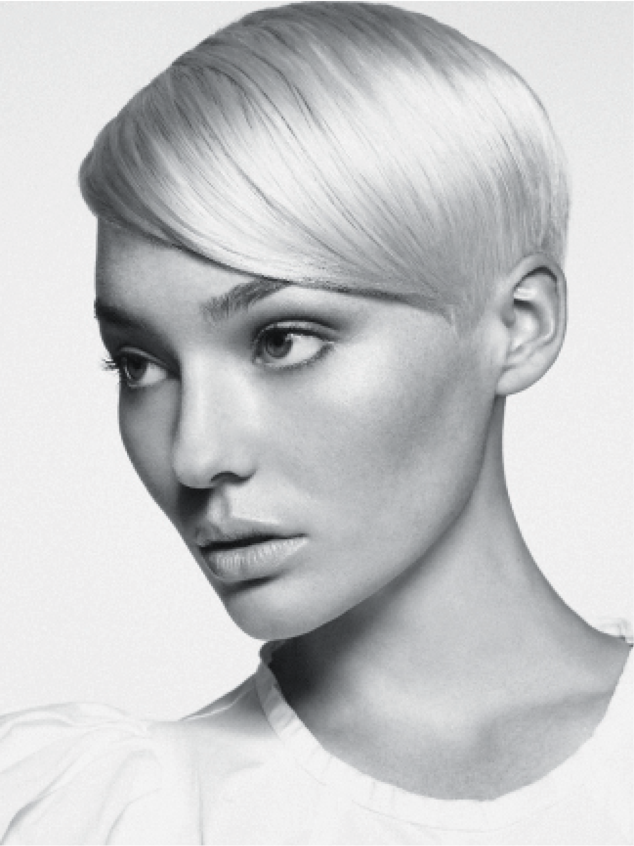 Turnbull used Matrix haircolor and developers for this Icelandic blonde. Then he relied on slide- and razor-cutting techniques for the bottom portions of the hair to achieve the desired length. He used Matrix products and blow-dried hair into place to finish.