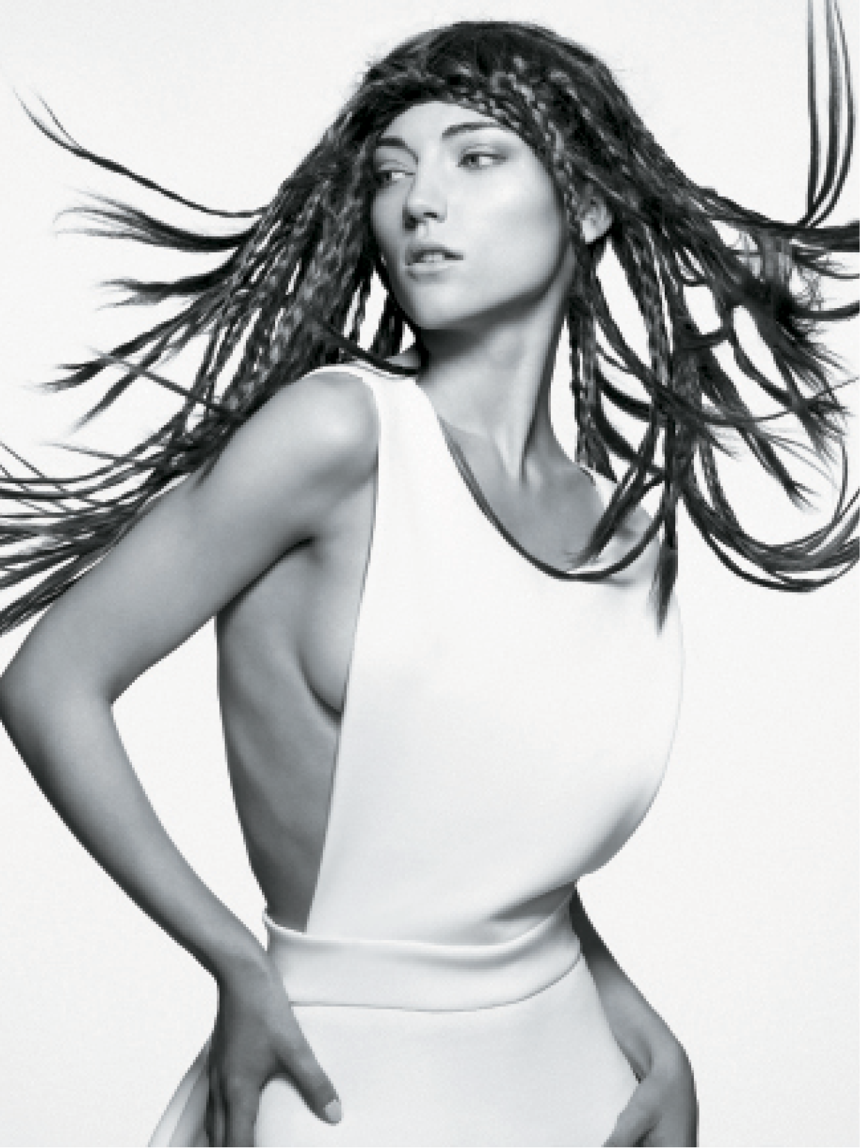 For this long, braided style, Turnbull first individually plaited sections of the hair and left the ends straight. A wind machine allowed the plaits to flow freely for the desired shot.