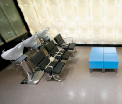 The wash area features modern decor like the bright blue coffee table, seen here.