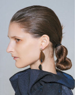 "Céline: ""I used Flex Mess Around 10 on the roots to give the hair a bit of hold and texture,"" Guido says. ""I wanted the product to hold the lines created as I raked my fingers through the hair. This technique made the style feel masculine in a way."""