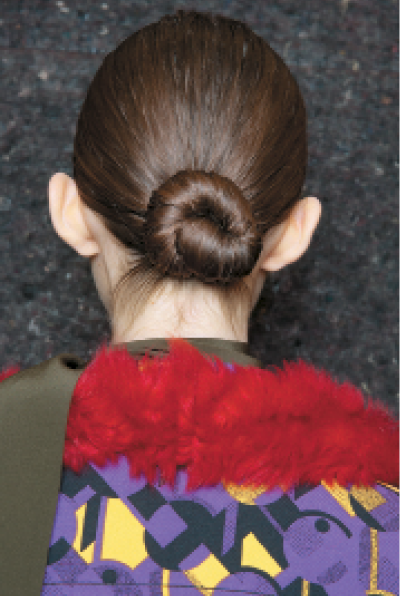 "Prada: ""The Prada show features a very basic idea of hair,"" Guido says. ""I was inspired by Visconti films and ballerina dancers. The ballerina-esque bun is minimal, imperfect and really shows off the model's unique features."""