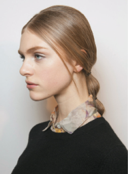 "Valentino: ""The collection this season felt more eclectic, so I wanted the hair at Valentino to be more whimsical and playful,"" Guido says. ""I created a simple part and added a little bit of height at the crown to give the hair a late '60s kind of feel."" KEY PRODUCTS: Redken Guts 10, Forceful 23"