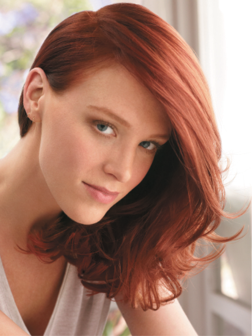 To prep this vibrant red hair, Markham and Wilson used SuperRich Shampoo and Condition before applying a blend of PlushLocks Leave-In Smooth and RadicallySmooth Anti-Frizz Serum. After blow-drying locks, they added PowderFix Texturizing Powder to enhance body and texture and form smooth, shiny waves.