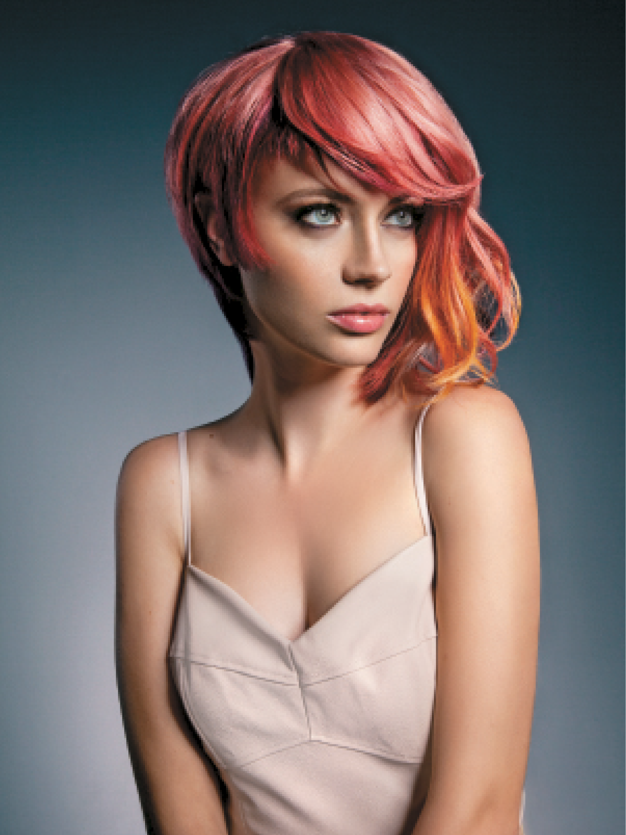 For the sunrise effect, Sprinkle used Metamorfix color and KeraHold color and developer, and started at a level 8. He suggests pre-lightening hair with It's a Blonde Thing Keratin Lightening System if necessary. Sprinkle first made circular partings around the head in an asymmetrical shape, and created a tropical orchid shade.