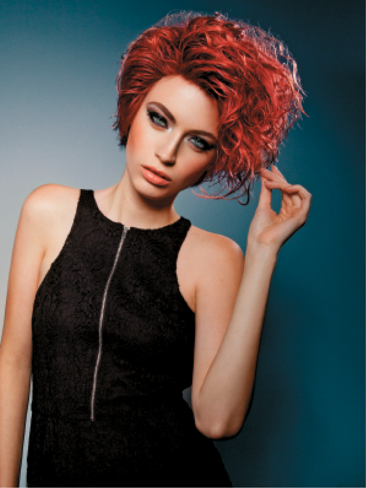 The carnival technique used for this look combines warm wood and sand hues with fiery red. Abraham Sprinkle started on hair at a level 6 and existing highlights at a level 8, then used Keratin Complex KeraBrilliance, Metamorfix and Demi-Glaze Activator for island wood, aurora red and titian sand shades.