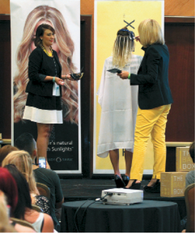 Candy Shaw, national educator and owner of Jamison Shaw Hairdressers, leads a class