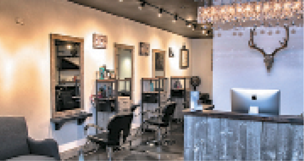 The salon has a warm ambiance and open floor plan