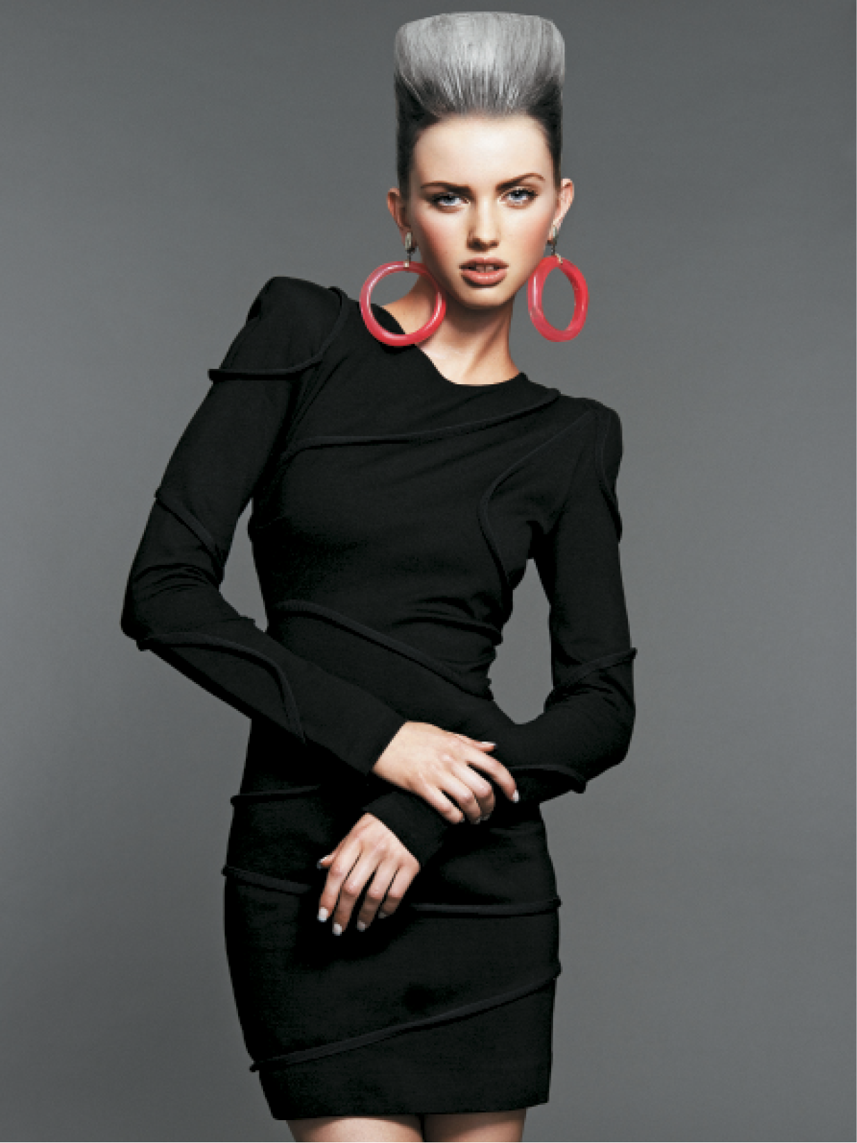The team built this square quiff by gathering sections of hair at the recession into a U-shape. They pulled the underneath section tight and French-twisted the tail. The duo then teased the top, applied hairspray and began framing the shape. To finish, they used a scarf and hairspray as one stylist added heat with a blow-dryer while the other held the scarf and formed the shape.