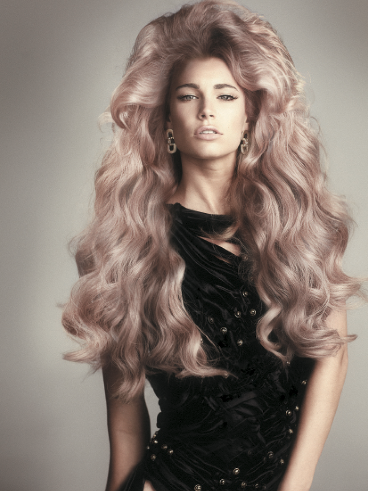 For these voluminous roots, Smith created 2-cm-wide sections and used a medium barrel tong to crimp the roots tightly right before the hairline. Smith flipped the hair and hairsprayed the roots, then teased the roots again for maximum lift.