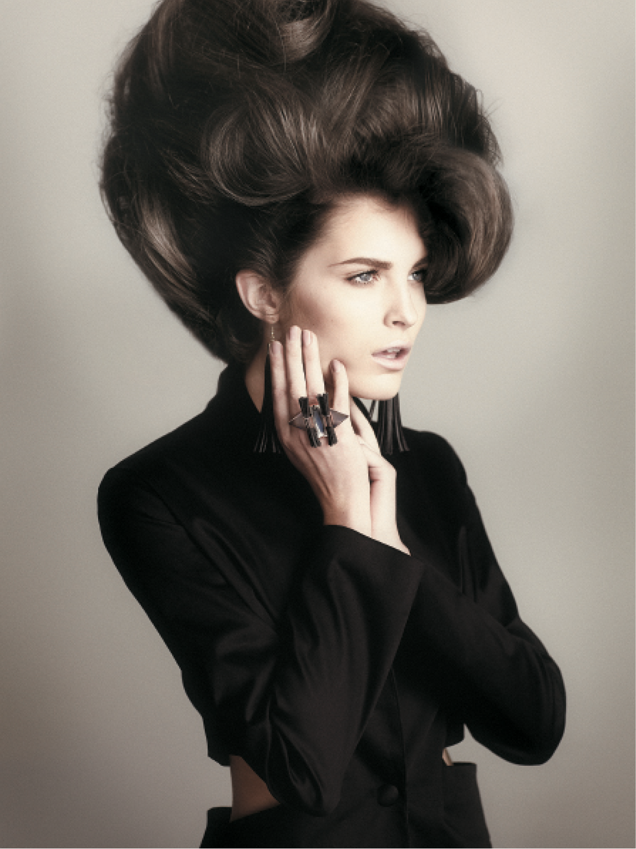 For this voluminous shape, Jo Smith took sections around the crown in a large halo pattern down to the occipital. To achieve a beehive height, she placed a large polystyrene ball with a smaller ball on top at the peak of the head and wrapped hair around and into a large French roll.