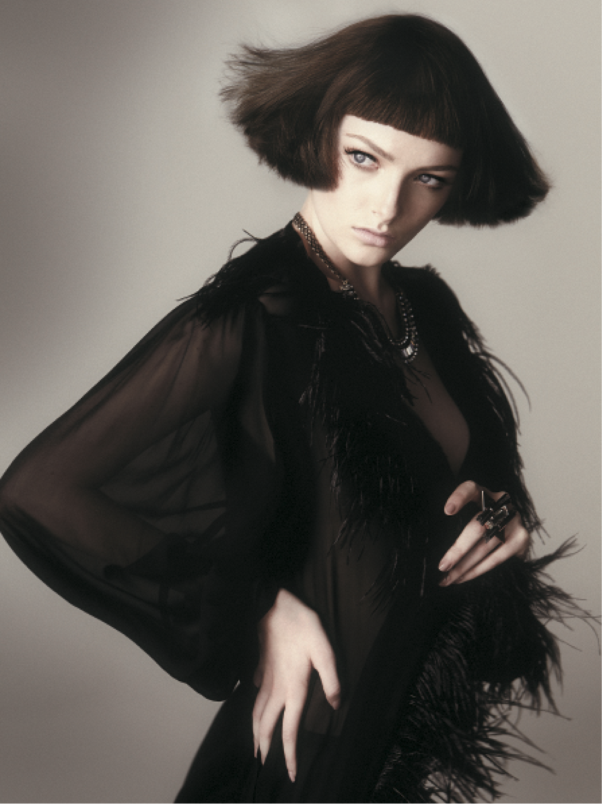 For this fluid bob, Smith used small clippers on a real- hair wig, cutting the back and sides with a block-graduation technique for a wide, stacked style. Using one finger of depth graduation, she cut to keep the fringe feathery. To finish, Smith used Shine Spray for gloss.
