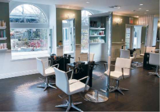 Crystal chandeliers and dark hardwood floors add to the elegance of Steven Mancini Salon