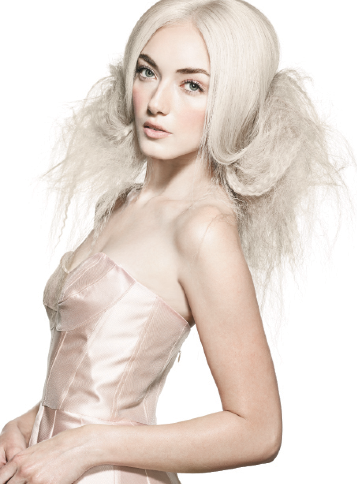 To create a faux fur collar incorporating the model's hair, Bossendorfer misted strands with Damage Manager before crimping them from the mid-lengths to the ends, leaving out the front section. She lightly backbrushed the hair for volume, placed bobby pins around the head just below the occipital and joined them for an anchor. At the center nape, she flipped a four-inch section, pinning the hair to the anchor and continuing to the side sections, which she rolled into the back. She used Fresh Hair to finish the look. Dress: A.B.S