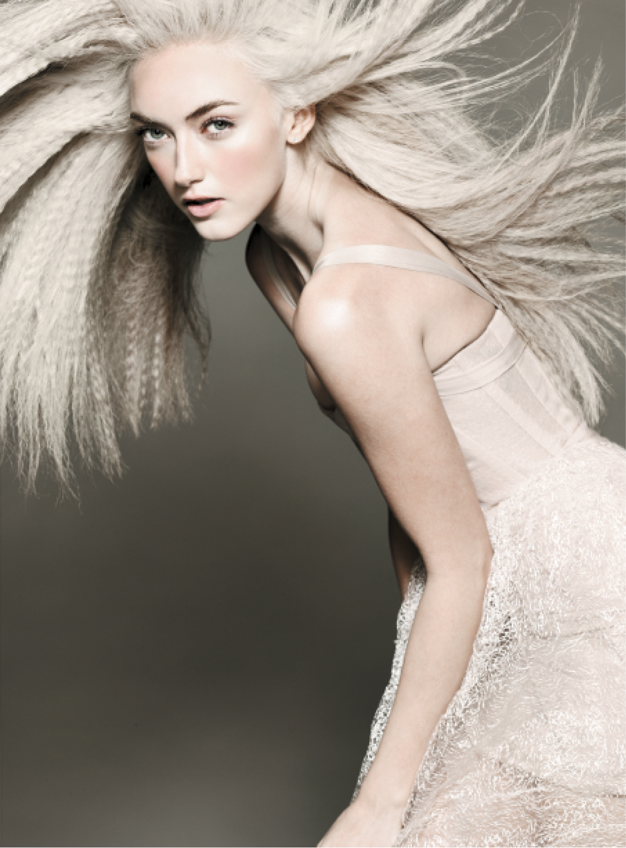 To create this look, Bossendorfer worked a bit of Powder Puff at the roots for volume. Next, she relied on a simple crimping technique from the base to the ends before applying Fresh Hair throughout strands for volume and fullness. Dress: Jad Ghandour