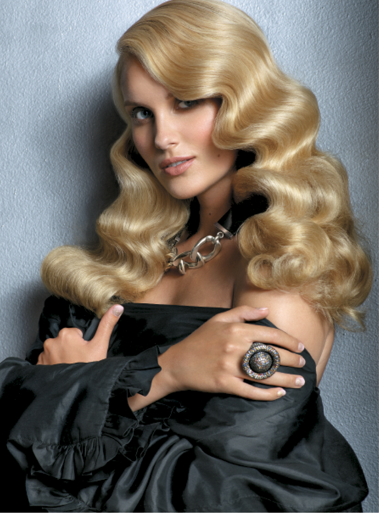 Giannandrea prepped the hair with Foaming Volumizer, then used a ¾-inch curling iron to create wave in medium sections before crafting a deep side part and misting the design with Control Hairspray. To finish, he used a paddle brush to define waves and Healing Oil to boost shine. Necklace: Pluma; Ring: M.C.L. by Matthew Campbell Laurenza