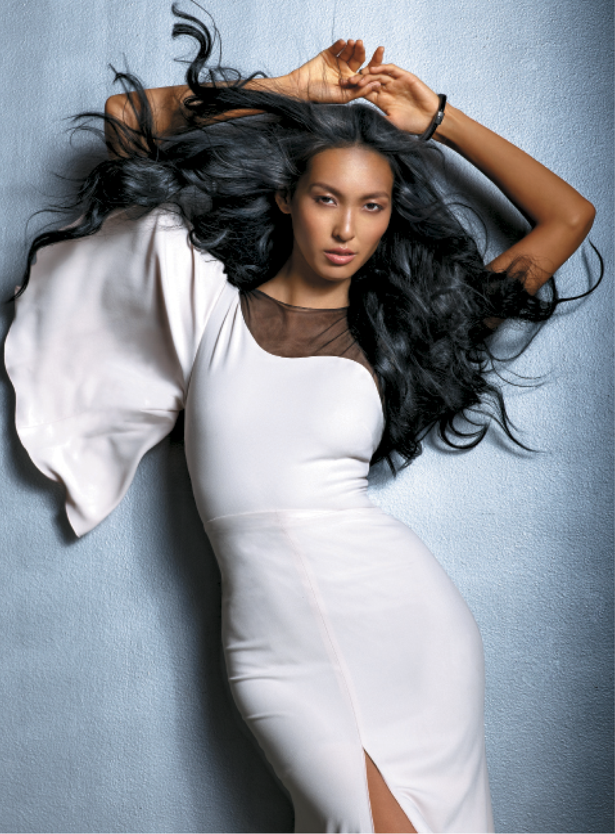 Giannandrea worked a bit of Blow Dry Lotion into strands before drying them for volume, then used a large curling iron and Control Spray to create waves. He used Whipped Detailing Cream to play up the style's smooth, rounded ends and to showcase the hair's health. Bracelet: M.C.L. by Matthew Campbell Laurenza; Dress: Maria Lucia Hohan